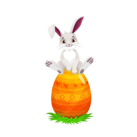 Easter bunny sitting on painted egg, Easter religious holiday and egghunting party. Vector white rabbit or hare animal with cute ears on spring green grass with orange egg and yellow pattern Illustration