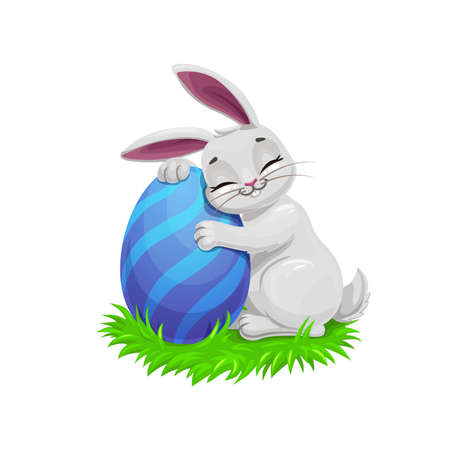 Easter holiday vector bunny or rabbit on easter egg hunt, egghunting party. Gray cartoon bunny on green grass holding a painted egg with blue stripe pattern, Christian religion holiday