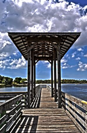 HDR shot of a fishing pier located in Florida.