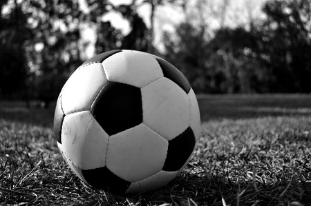 A black and white image of a soccer ball in the backyard. Stock Photo