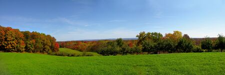 A beautiful panoramic shot of forest hills in the autumn.  Stock Photo