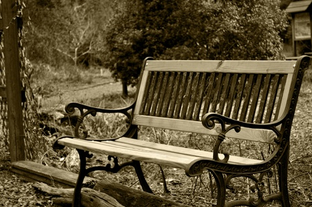 A sepia tone of a park bench.