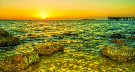 HDR Sunset on a Rocky Beach  Stock Photo