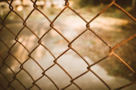rusty chain: rusty chain link fence