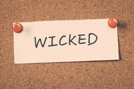 wicked: wicked word on note Stock Photo