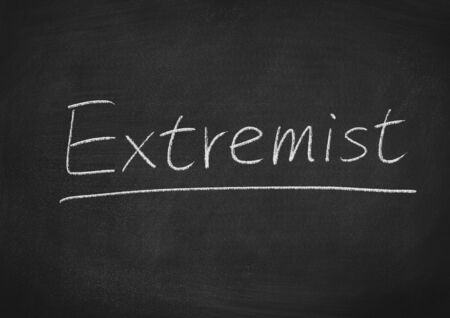 EXTREMIST concept word on a blackboard background
