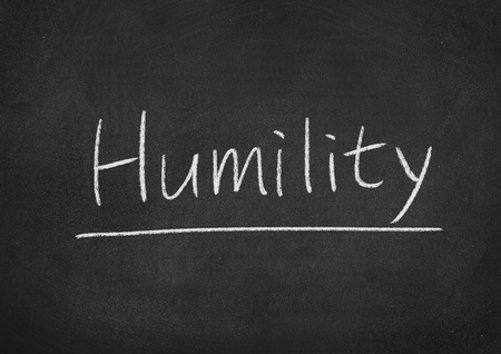 humility concept word on a blackboard background Stock Photo
