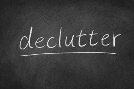 declutter concept word on a blackboard background