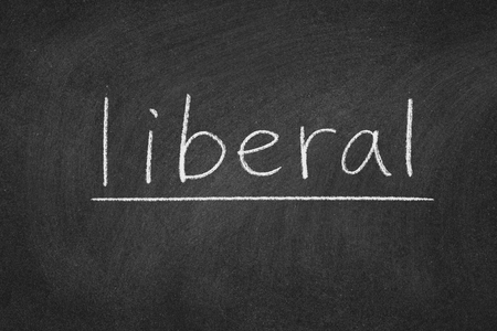 liberal concept word on a blackboard background Stok Fotoğraf