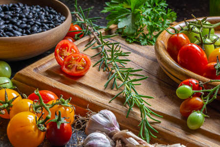 Fresh organic vegetables and ingredients on a wooden cutting board
