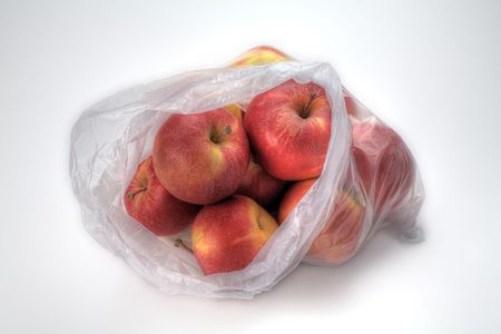 pips: A Plastic Bag of Gala Apples Isolated on White Stock Photo