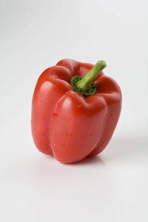 Red bell pepper isolated on white vertical