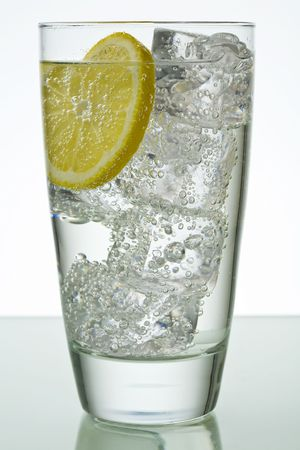 fizzy: Sparkling drink in glass with ice cubes and lemon slice Stock Photo