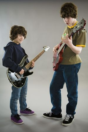 bass: Two boys playing guitar and bass Stock Photo