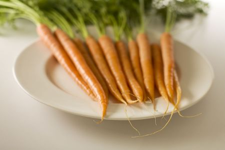 bunch of carrots on a plate with selective focus