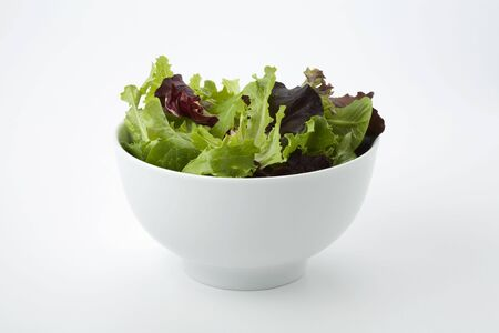 Mixed salad leaves in a white bowl