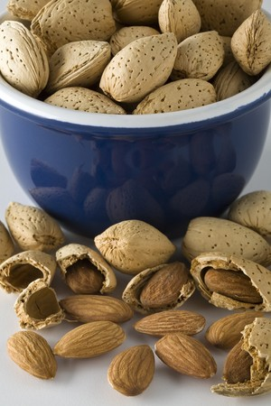 Small bowl full of raw almonds
