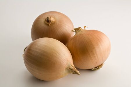 Three large onions isolated on white