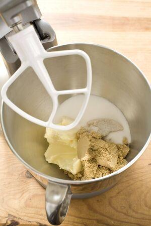 Cookie dough ingredients in mixer Imagens