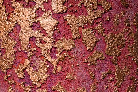 Gold and red stucco wall texture background. Stock fotó