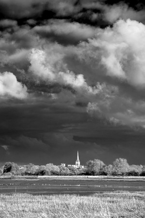 approaches: Chichester Cathedral as storm approaches Stock Photo