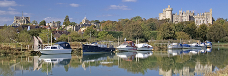 Arundel reflected in the River Arun on a still autumn, fall afternoon