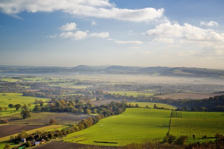 south downs: Mist and Autumn fall colours from the South Downs Way Stock Photo