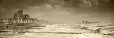 incidental people: Waves pounding onto the beach at Brighton Stock Photo