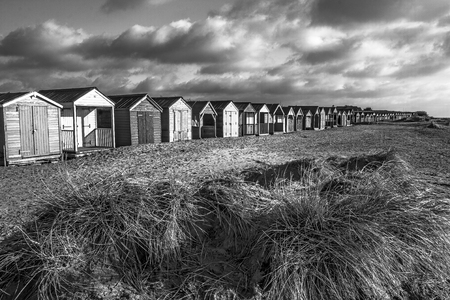 beach huts: a line of beach huts stretching into the distance