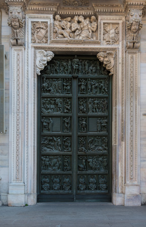 masonary: Intricate green door set within white frame masonary detailed stone Stock Photo