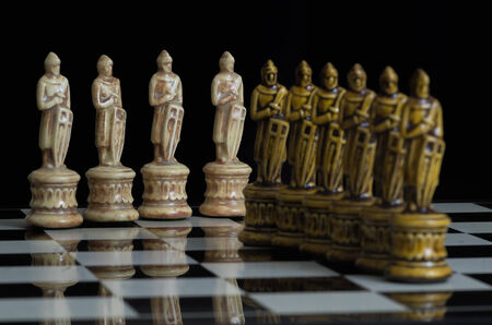 regard: Chess pieces arranged with regard to clean background and blur