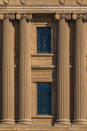 masonary: large columns framing windows in light tan masonary