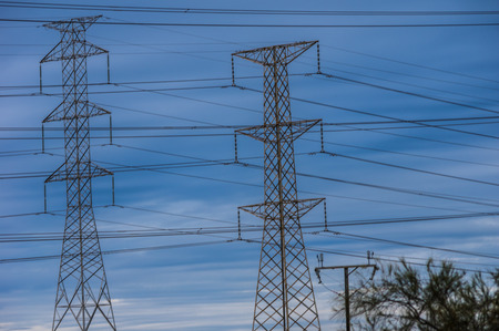 electric grid: Towers running cables for electricity supply Stock Photo