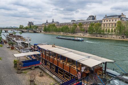 tour boats: Paris France 2014 April 22,  Tour Boats cruising along the Seine River in Paris