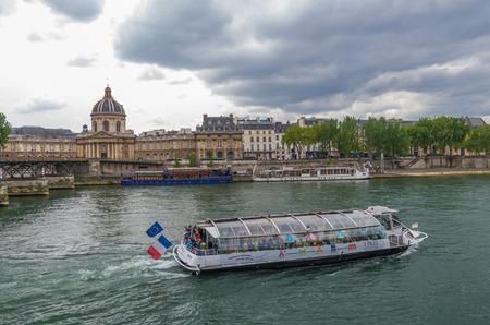tour boats: Paris France 2014 April 21,  Tour Boats cruising along the Seine River in Paris