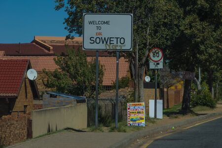 public houses: Johannesburg, South Africa 28 March 2016 The Johannesburg suburb of Soweto is a mixture of new public houses and poor dwellings Editorial