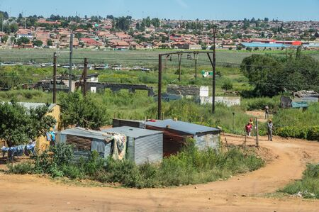 shanty: Johannesburg, South Africa 28 March 2016 The Johannesburg suburb of Soweto is a mixture of new public houses and poor dwellings Editorial
