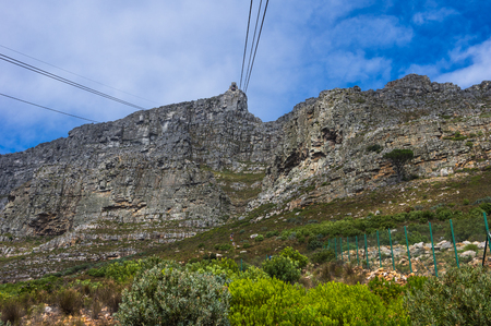 table mountain national park: Cape Town South Africa March 20 2016  The cable car tarverses  to the top of the famous Table Mountain Stock Photo