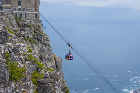 table mountain national park: Cape Town South Africa March 20 2016  The cable car traverses  to the top of the famous Table Mountain Editorial