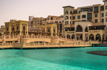 global city: Dubai United Arab Emirates 13 May 2014 Beautiful  Buildings and lake at the Dubai Mall in the global city  of UAE
