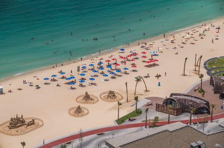 global city: Dubai United Arab Emirates 14 May 2014  Beautiful  beach and ocean water in the global city of Dubai Editorial