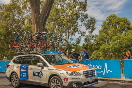 team from behind: Adelaide South Australia 22 January 2017 The Tour Down Under races around the street circuit of central Adelaide and is serviced by the professional team cars following the racers closely behind. Editorial