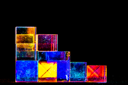 Abstract Cubes concept relecting bright prism colors in unique background 版權商用圖片