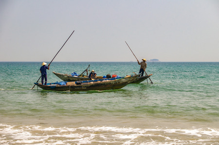 Traditional Vietnamese fishing along the beautiful coastline of Vietnam Stock Photo