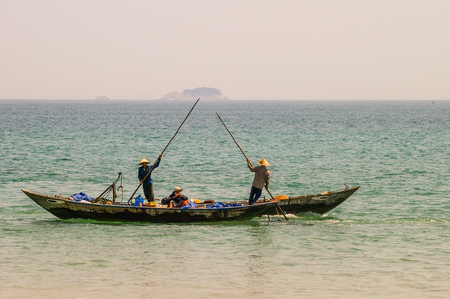 Traditional Vietnamese fishing along the beautiful coastline of Vietnam Editorial