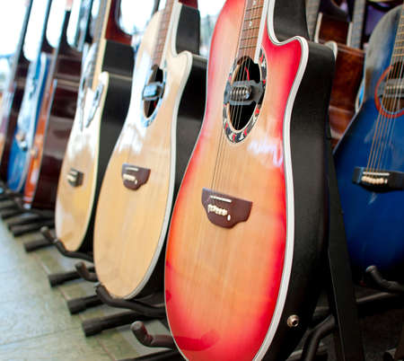 hymn: Different colorful guitars displayed that are for sale.