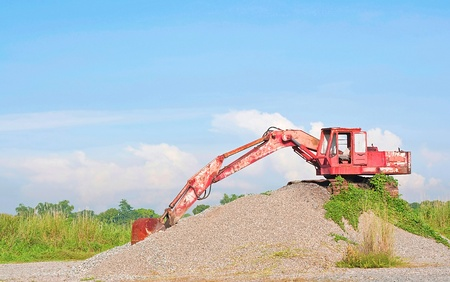 sand quarry: Old excavator on mound of sand