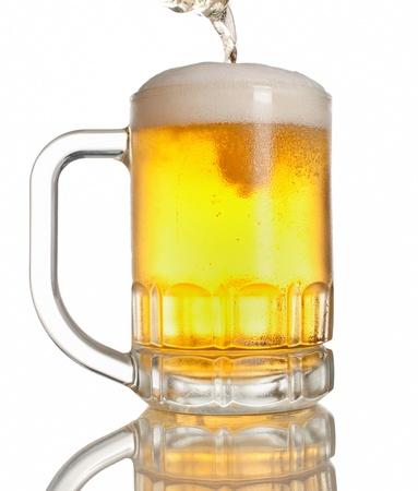 drafts: beer pouring on full mug