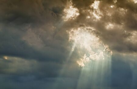 awe: light beams coming out from the clouds