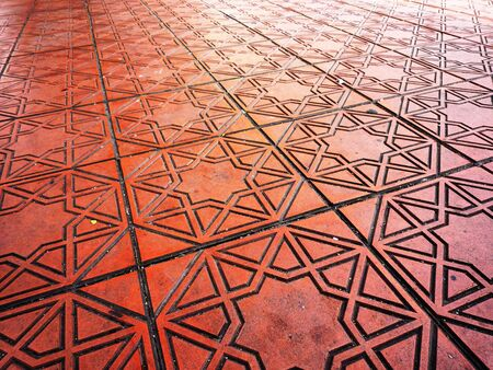 brown floor tile with star shape pattern photo